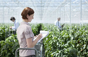 Lady with clipboard from UK strategy for agricultural technologies: executive summary