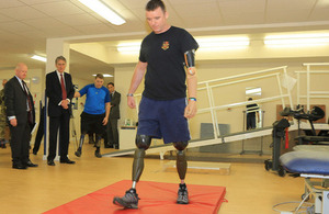 Corporal Matt Webb trying out his new prosthetic legs at Headley Court [Picture: Petty Officer (Photographer) Derek Wade, Crown copyright]