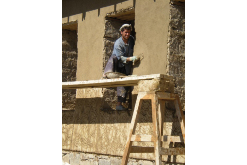 An Afghan worker using traditional construction techniques