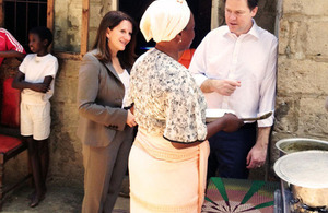 Photograph of Lynne Featherstone seeing a clean cookstove in Mozambique