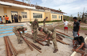 Service personnel working to repair the roof of Bitoon elementary school on Calagnaan island [Picture: Darren Fletcher Photography Limited]