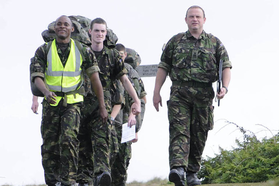 Able Seaman Fasuba at the head of his group completing a walk around the Rame Peninsular during his 10-week initial naval training course