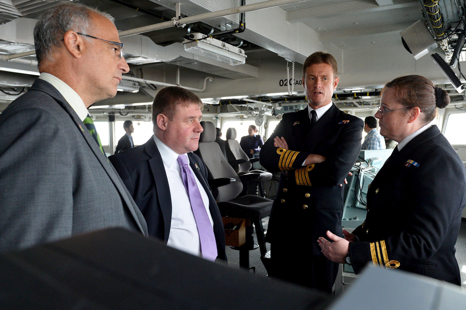 Michael Aron and Mark Francois are shown around HMS Bulwark