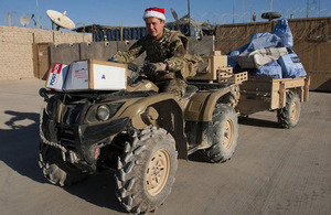 A British serviceman delivers Christmas post at Main Operating Base Price in Afghanistan (library image) [Picture: Corporal Dek Traylor, Crown copyright]