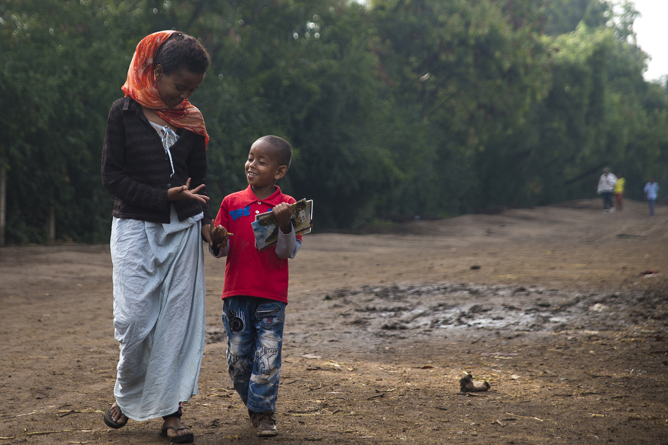 Momina walks her son Rapira, 6, to school. Picture: Benjamin Chesterton/duckrabbit/International HIV/AIDS