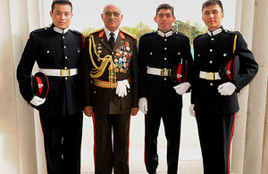 Left to right: Officer Cadet (OCdt) Soliman Khaleghy, General Sher Mohammad Karimi, OCdt Noor Rahimi, and OCdt Mahmood Yaqubi