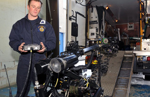 A Royal Navy bomb disposal expert operates the remotely-controlled Mark 8 Wheelbarrow robot