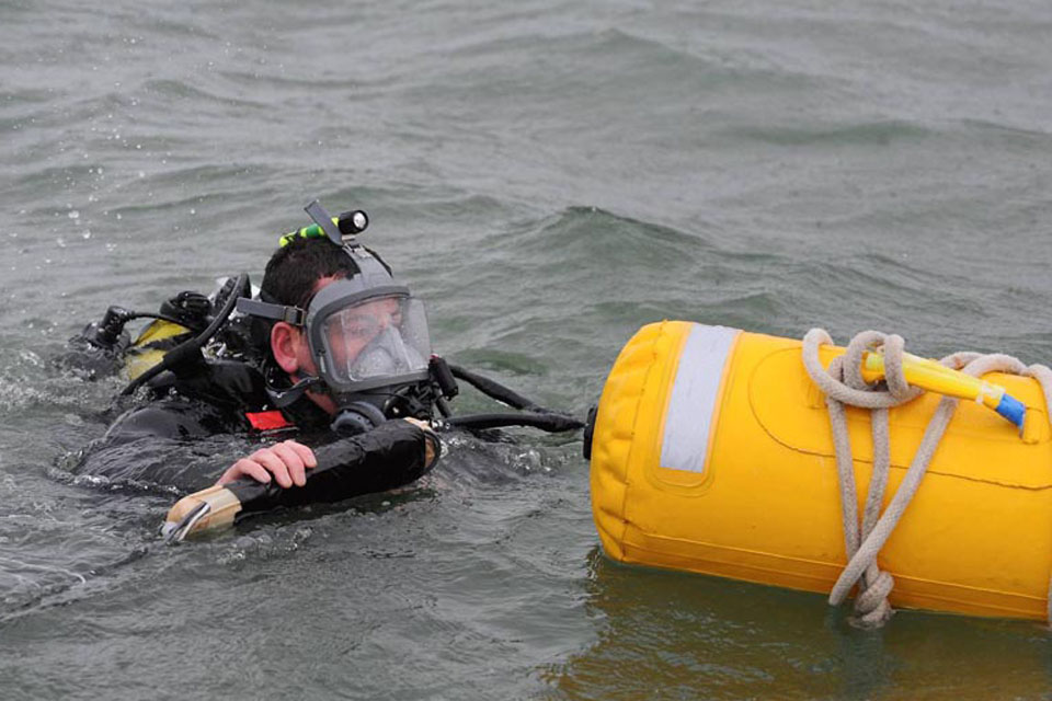 A Royal Navy diver prepares to dive to the bomb in Plymouth Sound in order to set the explosive charges