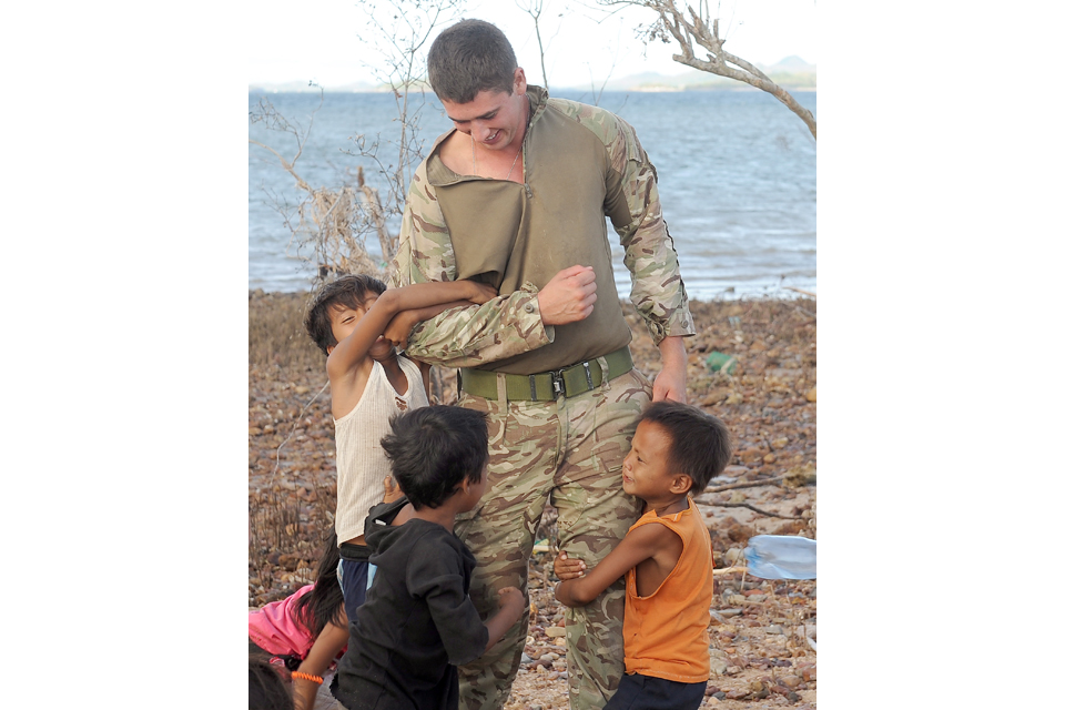 Local children with a Royal Marine