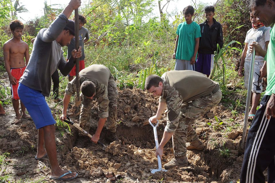 Royal Marines helping local villagers