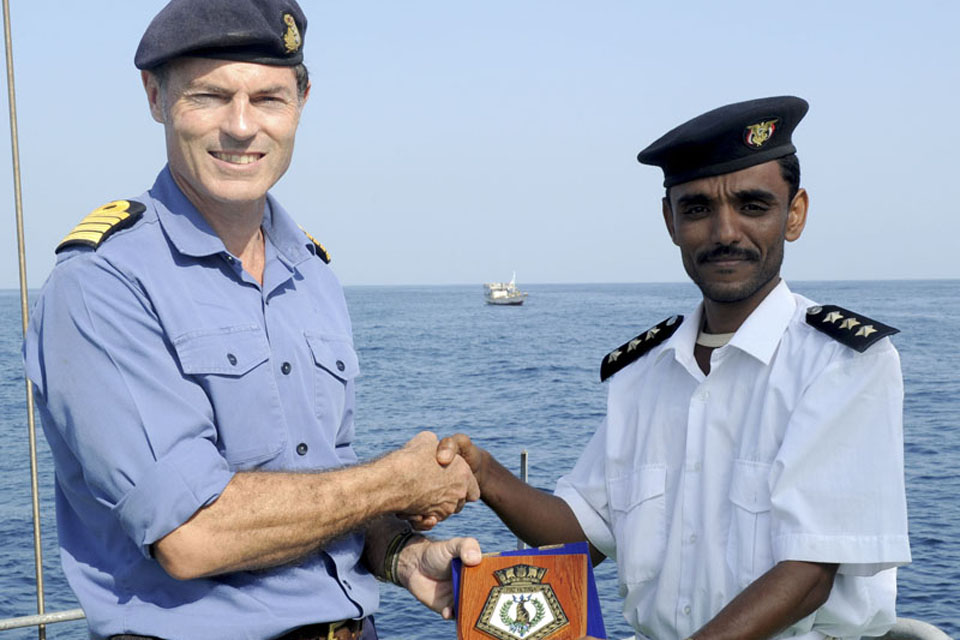 Captain Gerry Northwood presents a plaque to the captain of Yemeni Navy ship 1031