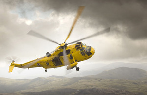 An RAF Search and Rescue Sea King helicopter banks over Snowdonia, North Wales (stock image)