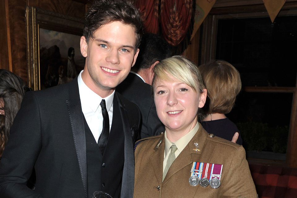 Jeremy Irvine with a serving member of the Royal Corps of Signals