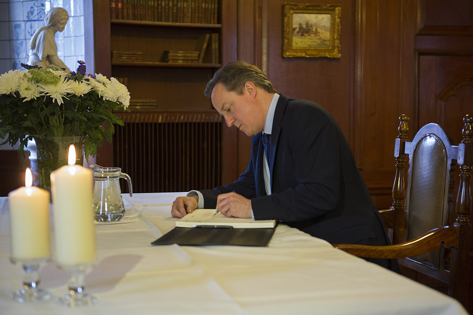 David Cameron writes in the book of condolence for Nelson Mandela at South Africa House