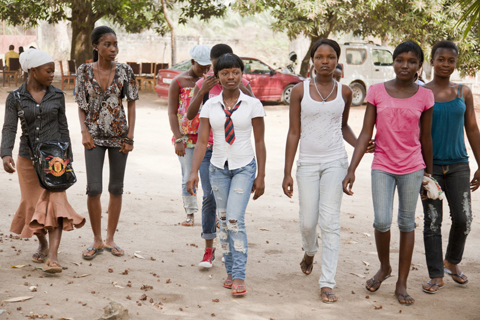A group of girls walk to an after school club in Sierra Leone. Picture: Plan UK