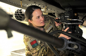 Aircraft engineering officer Captain Charlotte Joyce services an Apache helicopter's 30mm cannon [Picture: Sergeant Rupert Frere, Crown Copyright/MOD 2011]