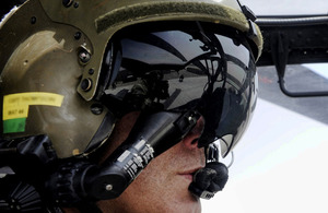 Army Air Corps pilot Captain Antony 'Thomo' Thompson in the cockpit of his Apache helicopter in Helmand province, Afghanistan