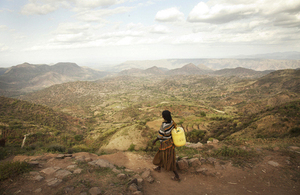 An Ethiopian woman walks home having collected clean water. Picture: WaterAid / Anna Kari