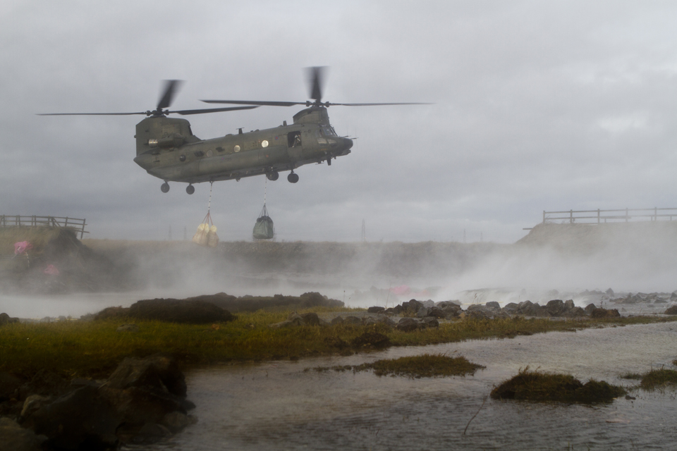 An RAF Chinook with an underslung load of bagged aggregate