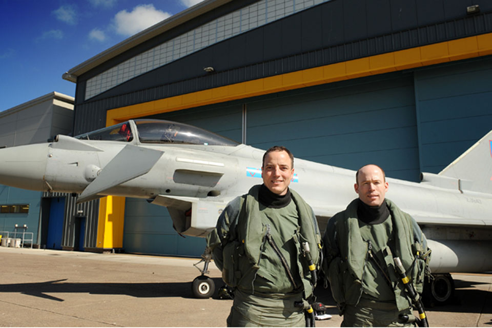Squadron Leader Matt Peterson (right) and Wing Commander Roddy Dennis with an RAF Typhoon