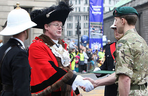 The Lord Mayor of London, Alderman David Wootton, presents a Royal Marines Reservist with his Operation HERRICK campaign medal