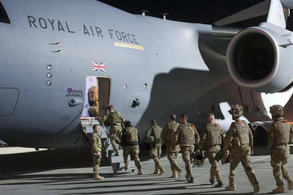 UK troops boarding a C17 aircraft.