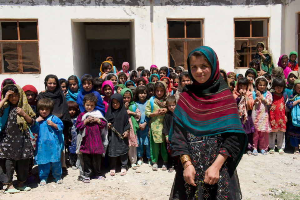 Afghan girls standing outside a school.