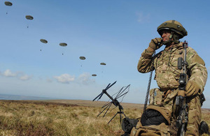 A 16 Air Assault Brigade signaller on the radio as troops make an airborne insertion during Excercise Joint Warrior