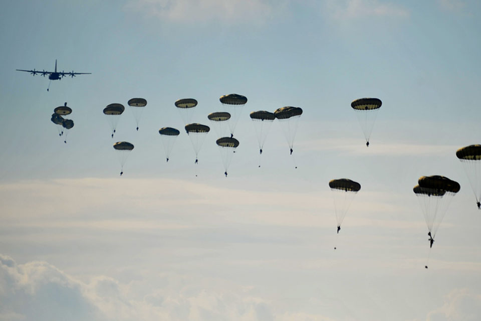 Troops from 16 Air Assault Brigade parachute from a C-130 Hercules during Exercise Joint Warrior