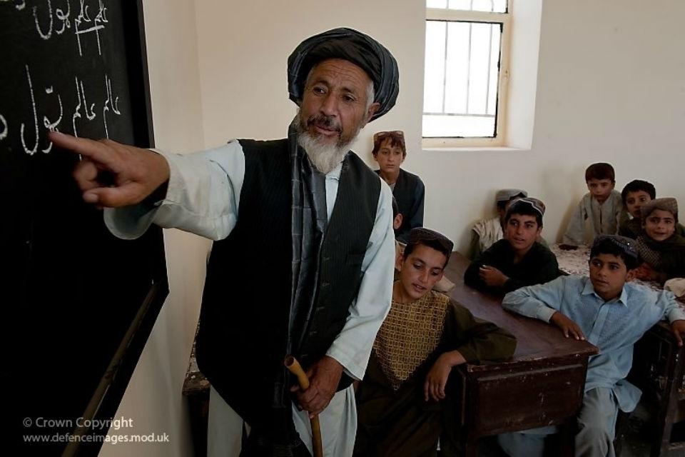Afghan boys with their teacher in school.