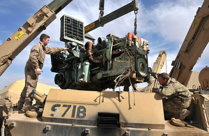 Vehicle mechanics changing a power plant on a Challenger armoured repair and recovery vehicle (library image) [Picture: Corporal Wes Calder RLC, Crown copyright]
