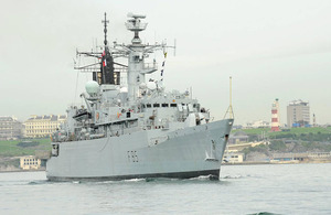 HMS Cumberland passes Plymouth Hoe on her way out of Devonport Naval Base (stock image)