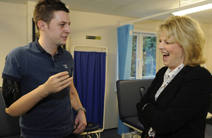 Corporal Andrew Garthwaite demonstrates his 'thought-controlled' prosthetic arm to Defence Minister Anna Soubry [Picture: Sergeant Pete Mobbs, Crown copyright]