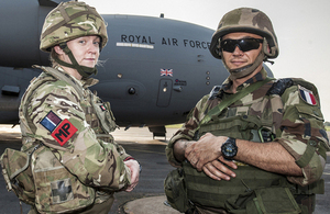 A member of the RAF Police and a French serviceman stand guard whilst the C-17 is unloaded at Bangui Airport [Picture: Corporal Neil Bryden RAF, Crown copyright]