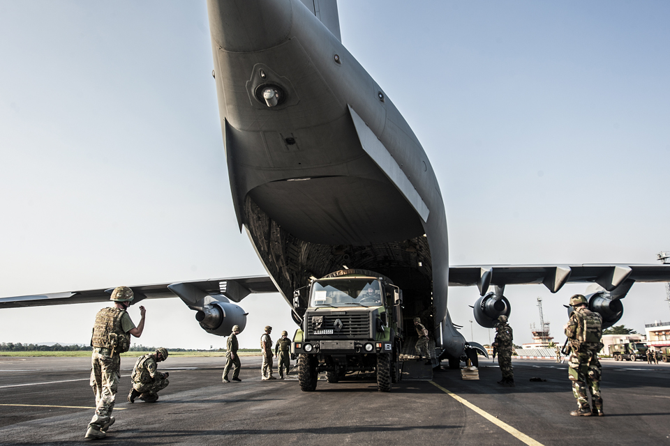 Unloading military equipment from the C-17