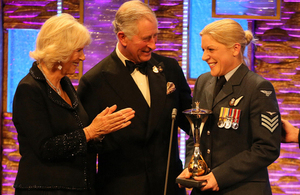 Prince Charles and the Duchess of Cornwall presenting the Most Outstanding Airman Award to Sergeant Anna Irwin [Picture: Copyright The Sun]