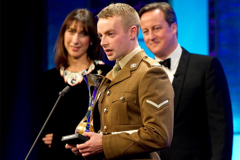 Samantha and David Cameron listen to Lance Corporal Keith Mallon's acceptance speech