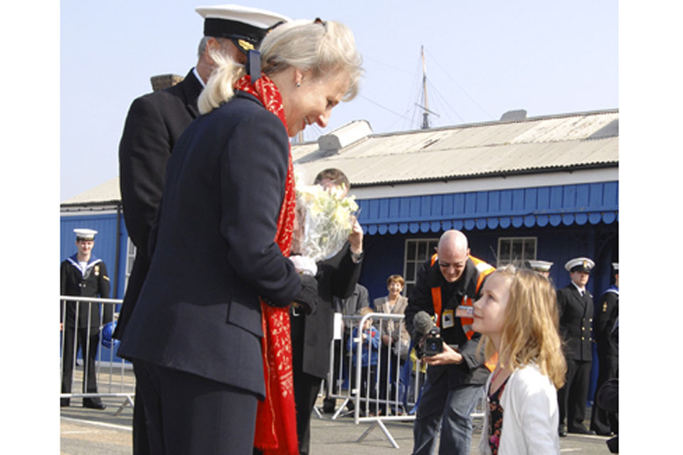 The Duchess of Gloucester receives flowers from Lieutenant Commander Stride's (the Executive Officer) daughter Catherine