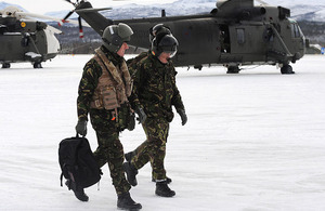 Admiral George Zambellas (left) walks out onto the flight line at Bardufoss airfield