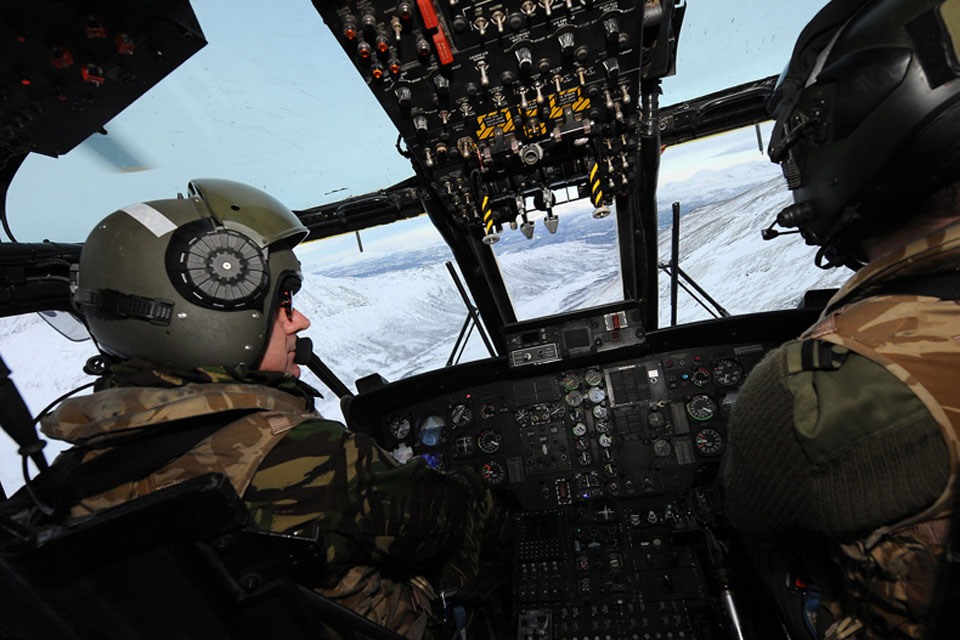 Admiral George Zambellas at the controls of a Commando Helicopter Force Sea King Mk4 helicopter during a flight over the Bardufoss training area