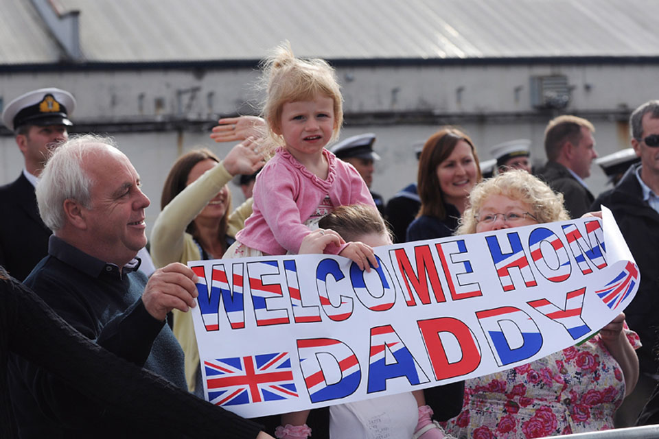 Families and friends wait to welcome home their loved ones as HMS Grimsby returns to her home port of HM Naval Base Clyde