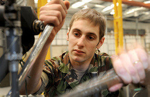 Corporal Mike Lacchin working on an Apache helicopter at Wattisham Flying Station in Suffolk