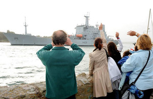 A crowd waves from Devil's Point as HMS Scott leaves Devonport Naval Base