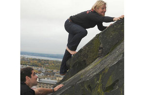 Major Ellen Bruce climbs barefoot up to Edinburgh Castle to mark the beginning of the European Military Climbing Championships