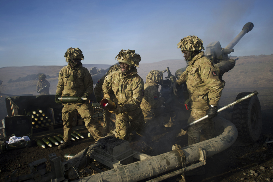Soldiers of the Royal Artillery firing 105mm Light Guns