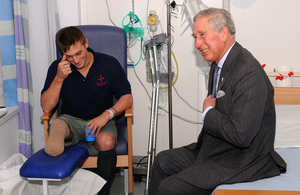 Prince Charles shares a joke with Marine Adam Coatsworth during his visit to the Queen Elizabeth Hospital Birmingham [Picture: Crown copyright, University Hospitals Birmingham NHS Foundation Trust]