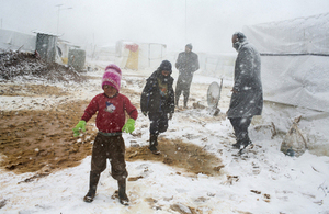 Syrian refugees brave the cold during heavy snowfall at the Terbol tented settlement in the Bekaa Valley last week. Picture: UNHCR/A. McConnell