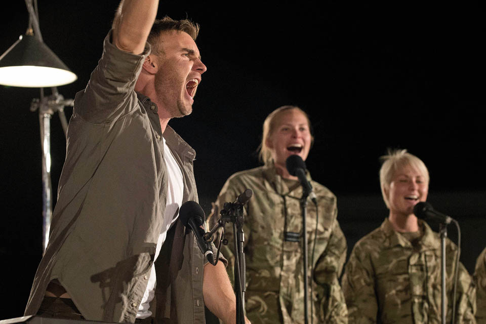 Gary on stage with members of the Armed Forces as his backing group
