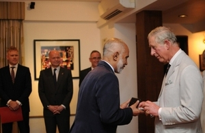 Mr Ismail receives his award from HRH The Prince of Wales.