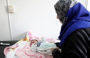One-month-old baby boy, Walid, is comforted by his mother after a check-up. Picture: Russell Watkins/DFID